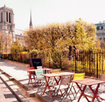 An outdoor cafe next to Notre Dame Cathedral in Paris